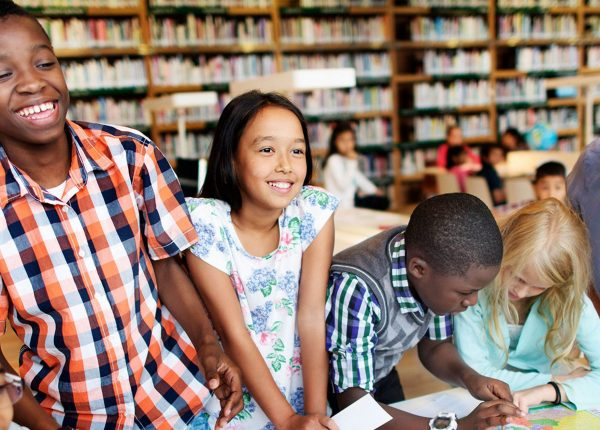 Students Around Table in Library
