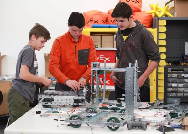 Three Teens Building Mechanics Set