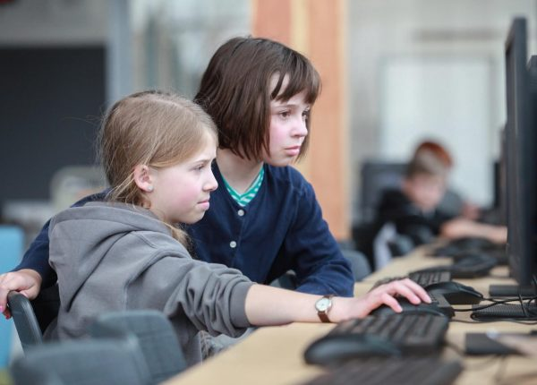 Two girls at computer