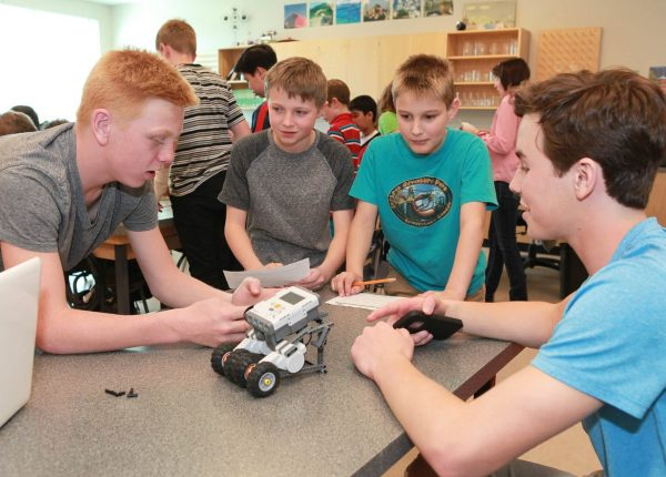 Four students working on Lego robotics