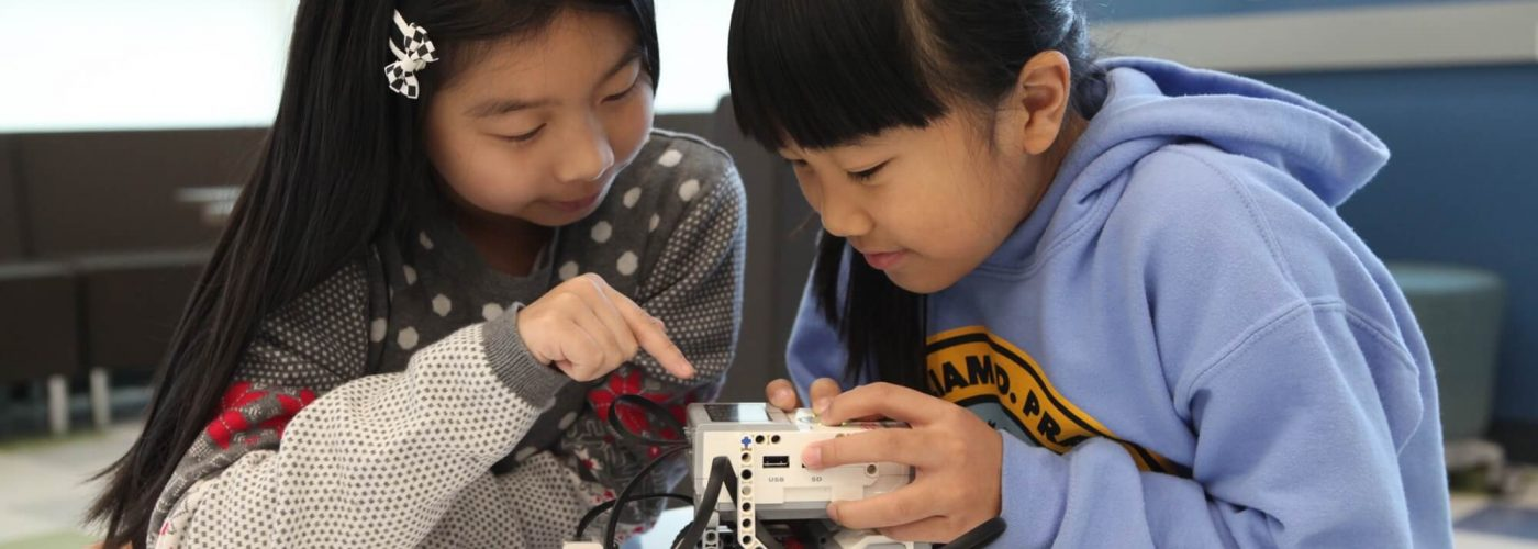 Two Girls with Robotics Set
