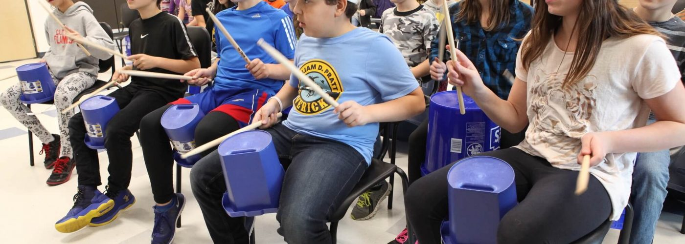 Group of Kids Playing Drums
